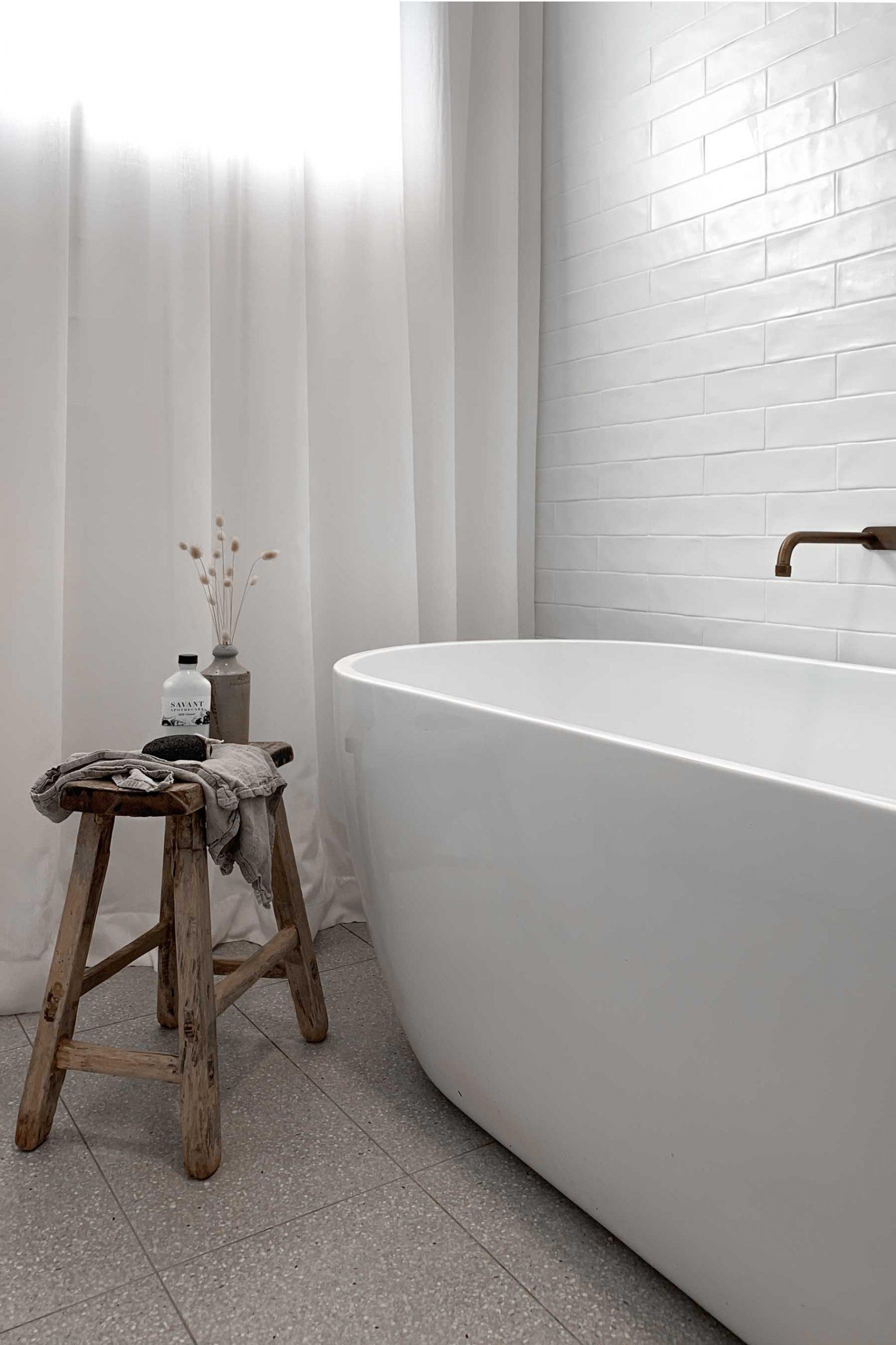 Minimalist bathroom with curtains
